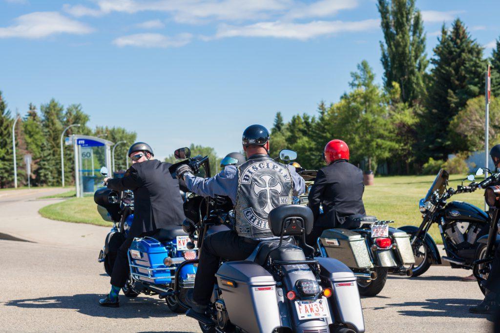Groomsmen on motorcycles heading to the ceremony