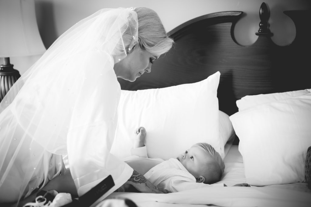Bride getting her son ready for the wedding