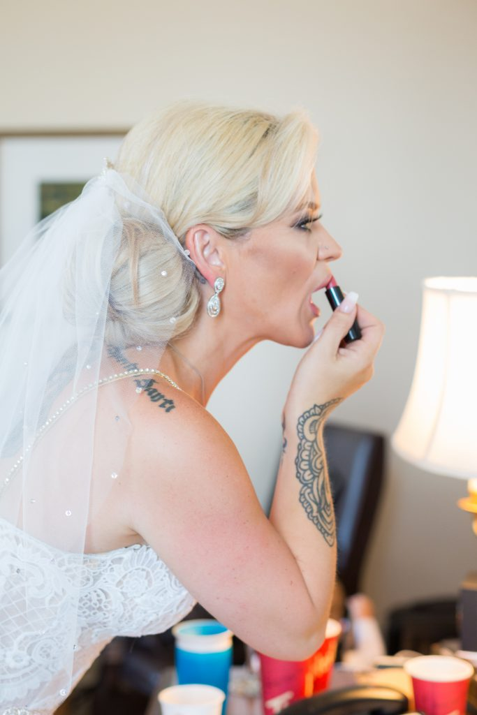 Bride putting on her lipstick