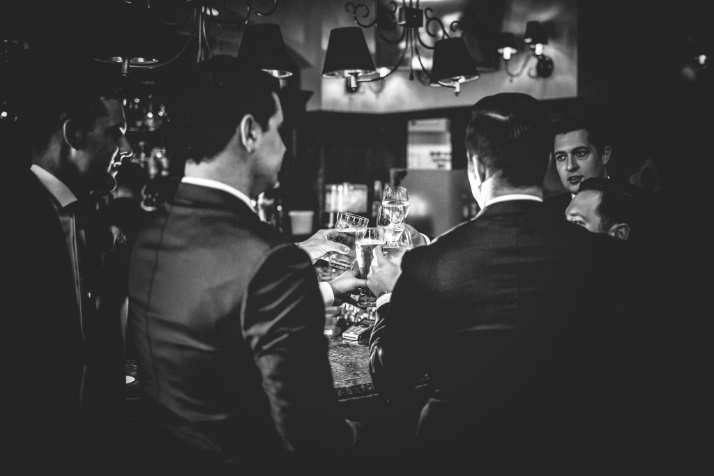 Groomsmen sharing a drink before the ceremony