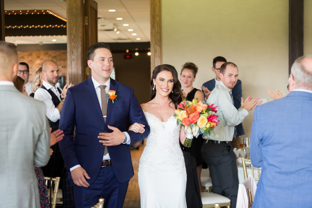 bride and groom making their entrance