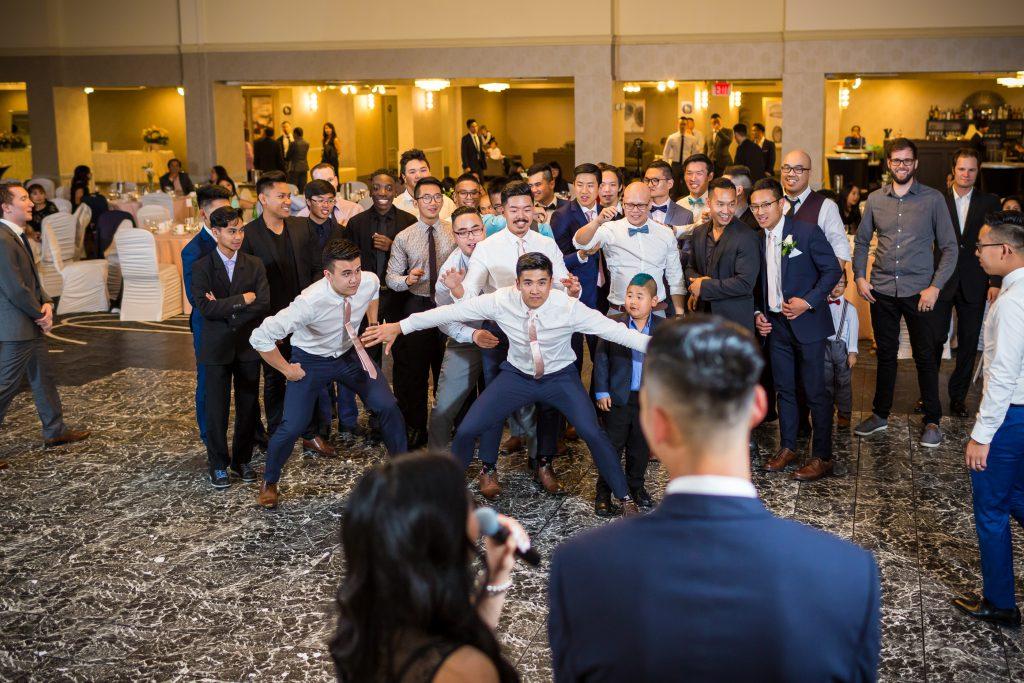 groomsmen waiting for garter toss