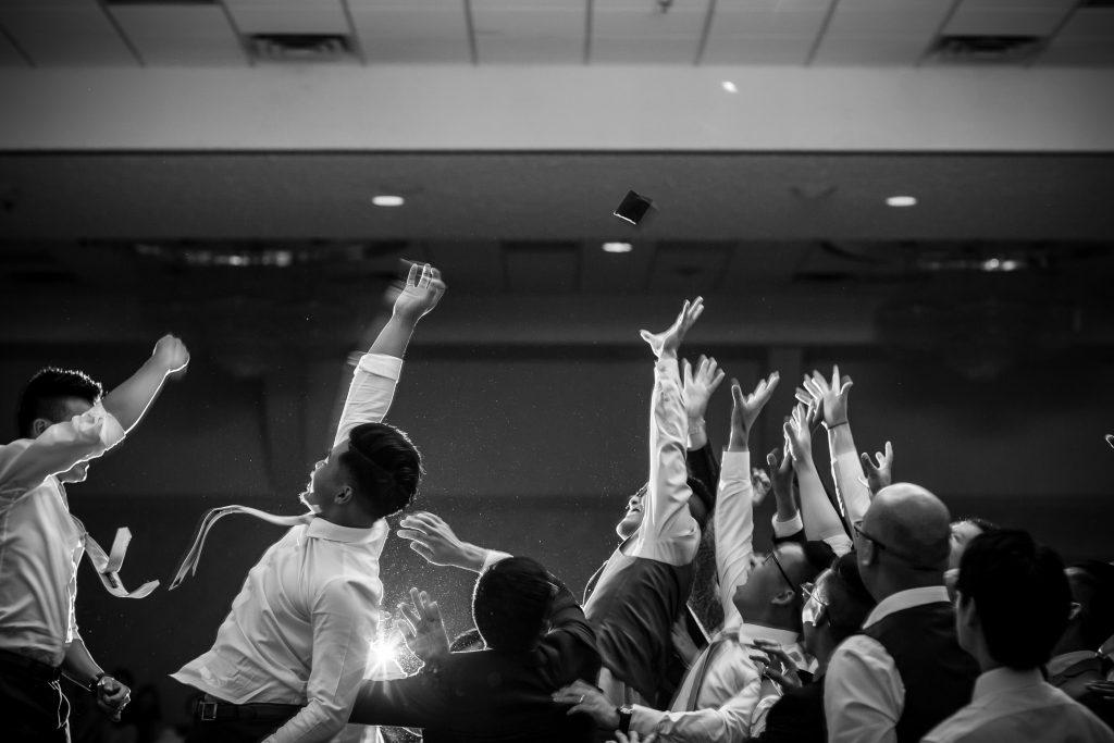 wedding reception garter toss photo