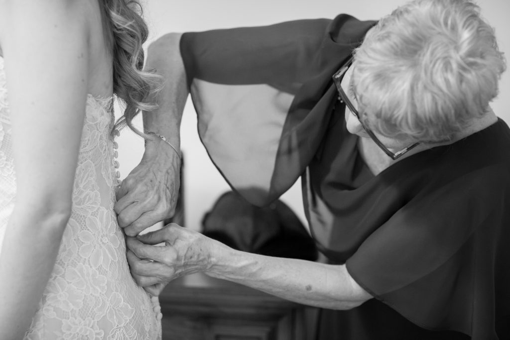 Wedding detail photo of bride getting dressed