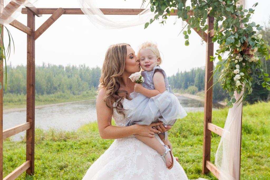 bride with flowergirl