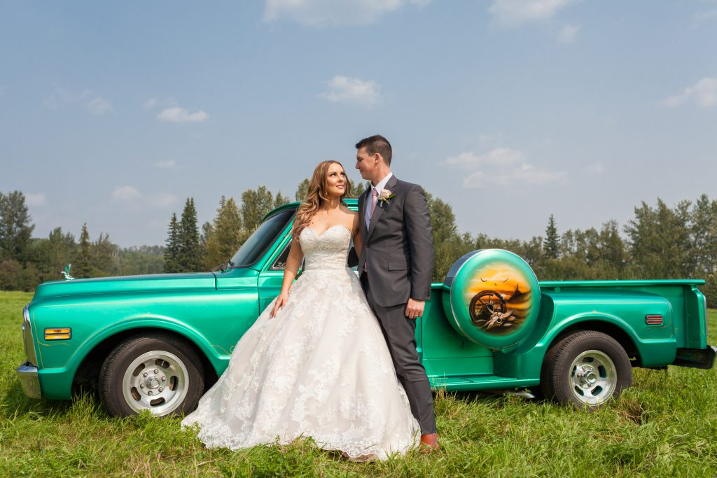bride and groom with classic truck