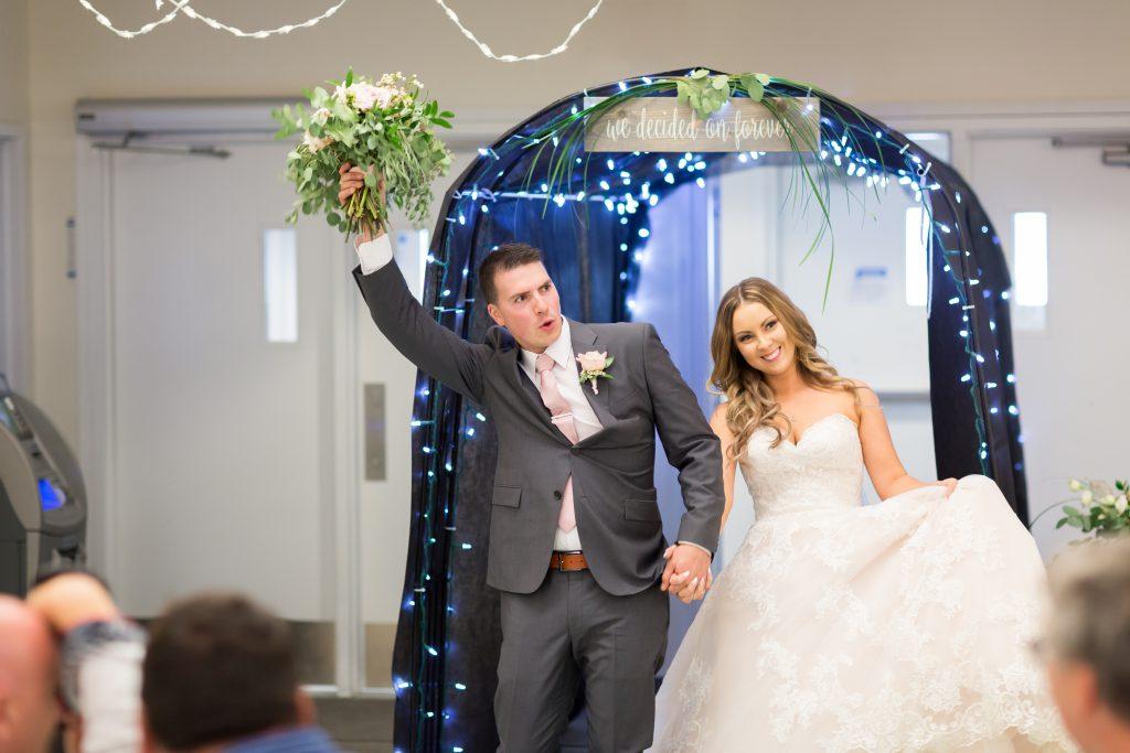 bride and groom entrance into reception