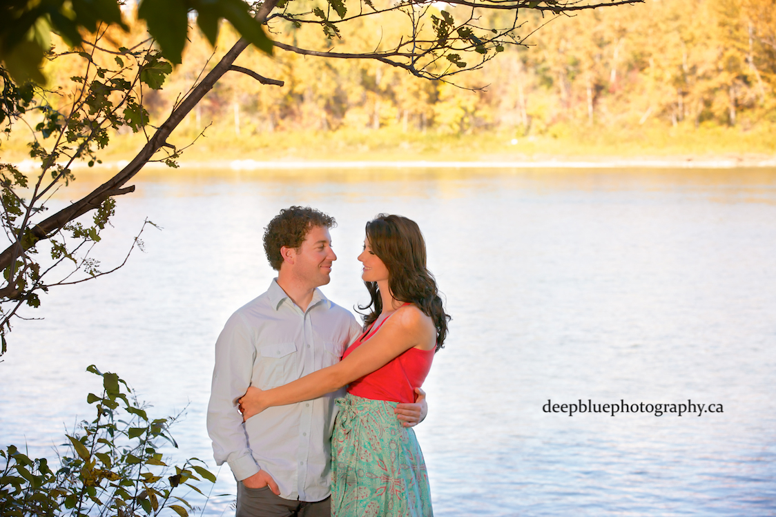 Photo of Couple by the River In Their Edmonton River Valley Engagement Pictures