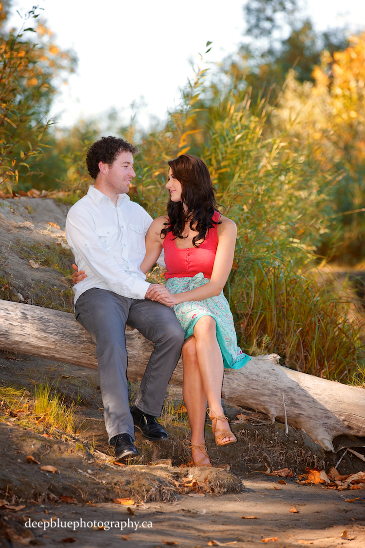Photo of Couple Sitting on a Log - Edmonton River Valley Engagement Pictures