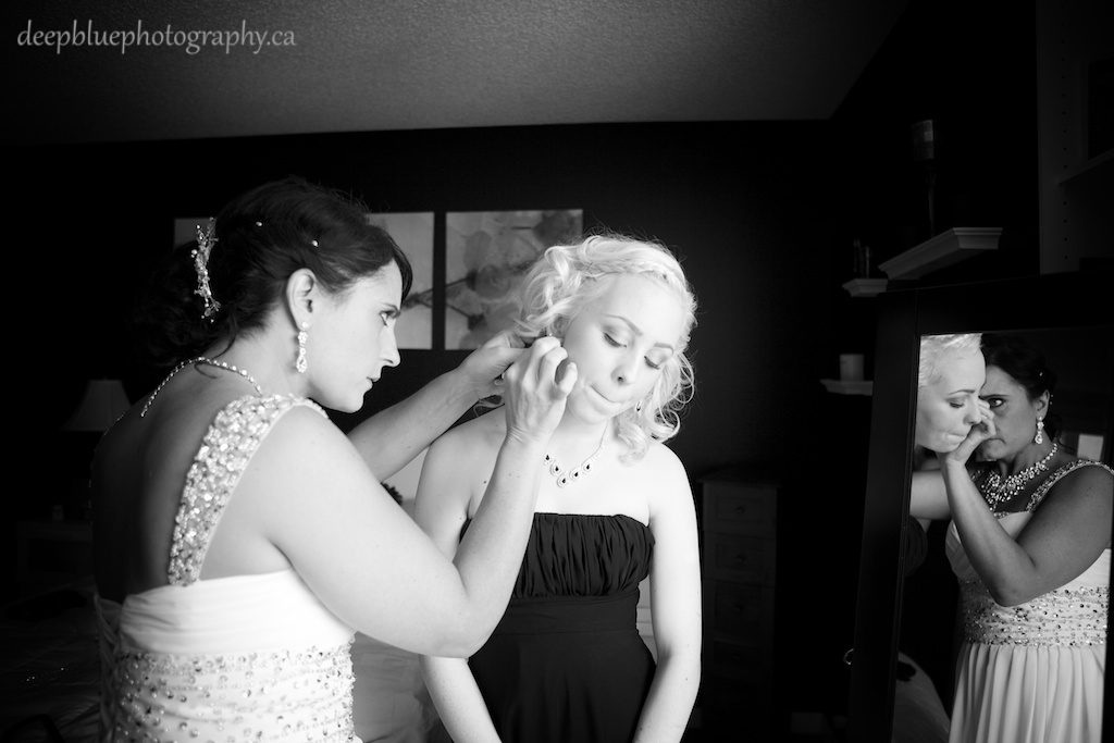 Bride Helping her Daughter with Earrings