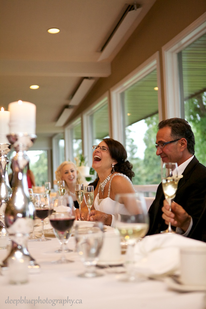 Picture Of Bride Laughing At Speeches At An Edmonton Golf And Country Club Wedding