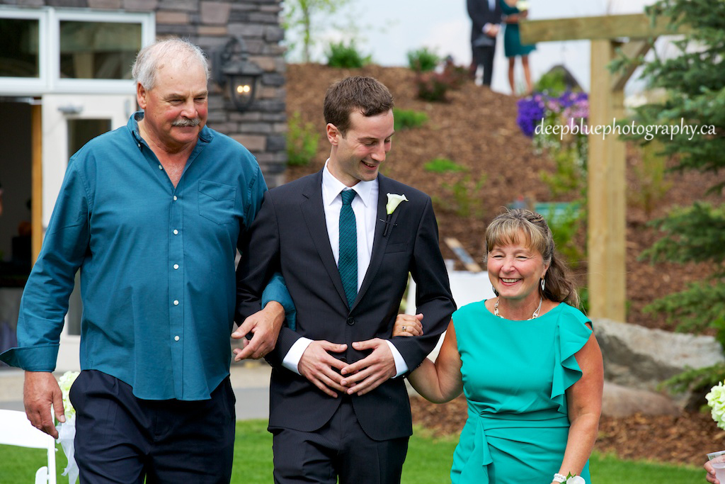 Photo of Groom Walked Down Aisle By Parents At A Countryside Golf And Country Club Wedding