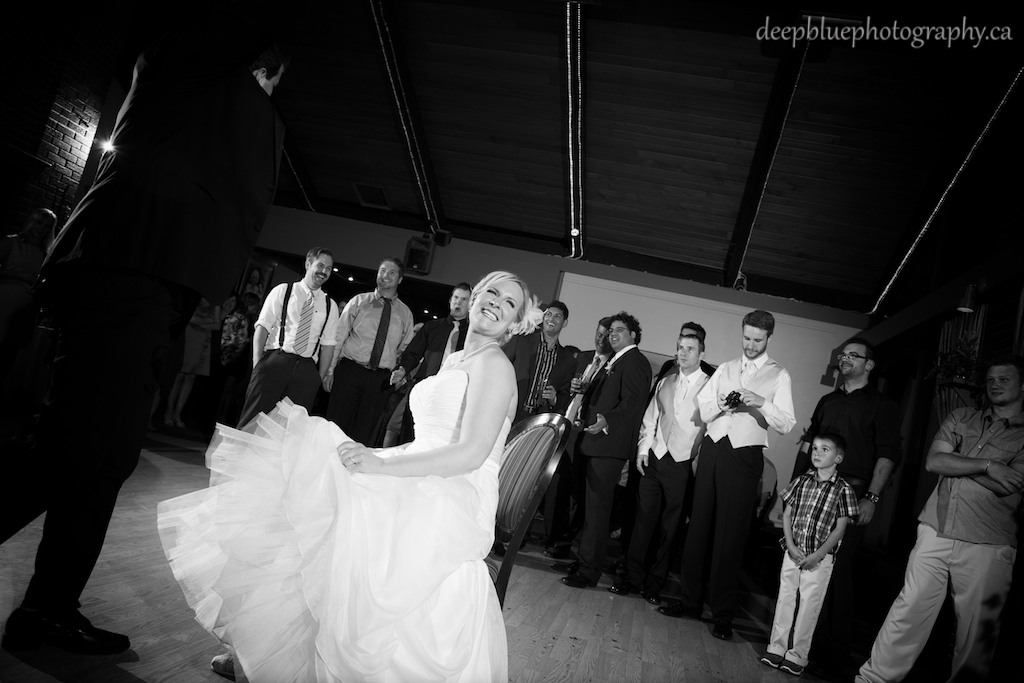 Photo of the Bride During the Garter Toss At Faculty Club Wedding