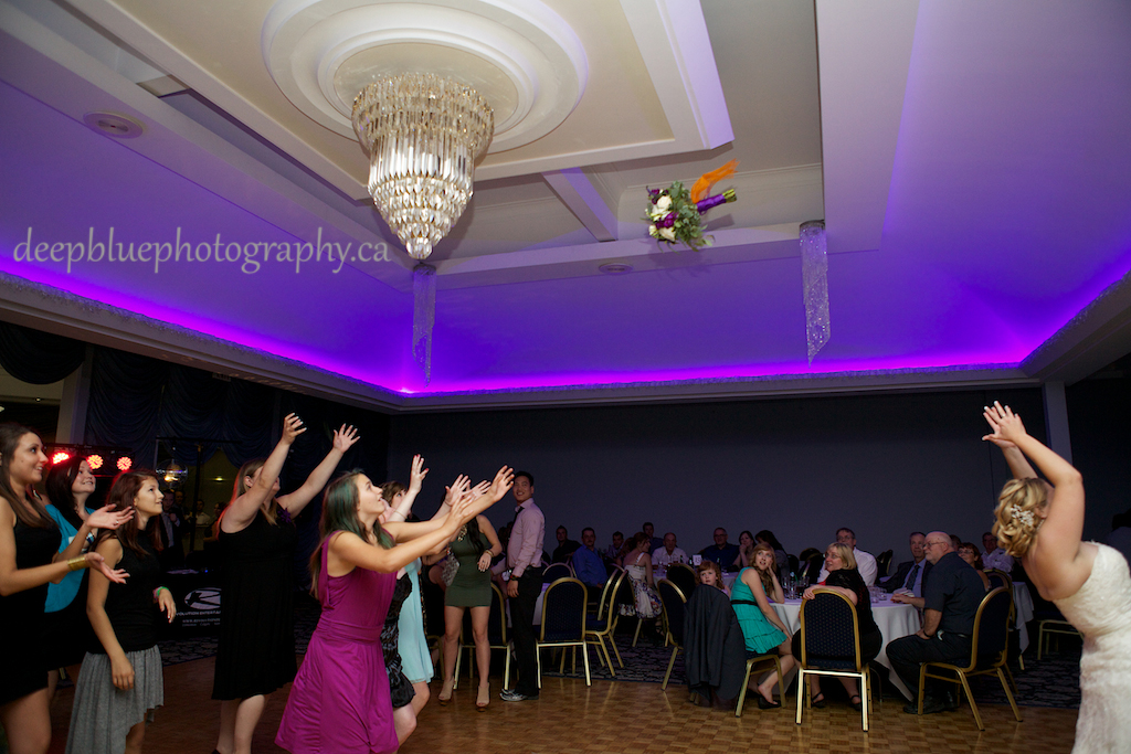Bride Bouquet Toss at Chateau Louis Hotel Wedding Reception