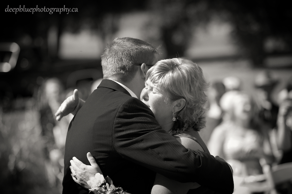 Tyler and his Mother Hugging at the Ceremony
