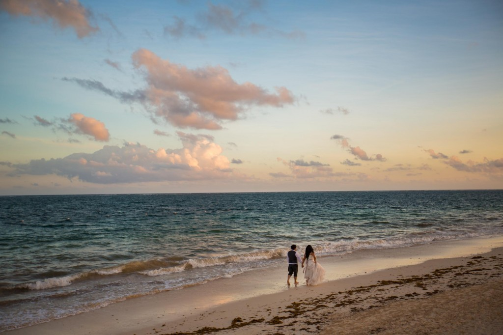 How to Plan a Destination Wedding - Sunset Picture Of Bride And Groom On Beach