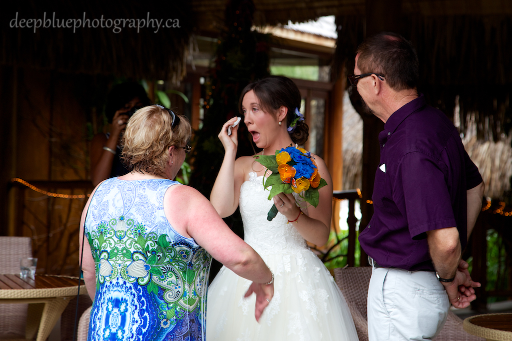 Photo of the Bride Meeting Her Parents At A Destination Wedding In Tahiti