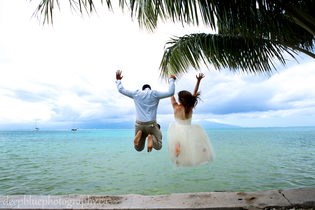 Photo of Bride and Groom Jumping into Ocean Tahiti Destination Wedding