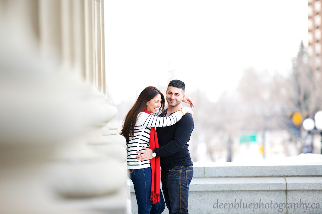 A Couple Laughing During Their Alberta Legislature Engagement Pictures