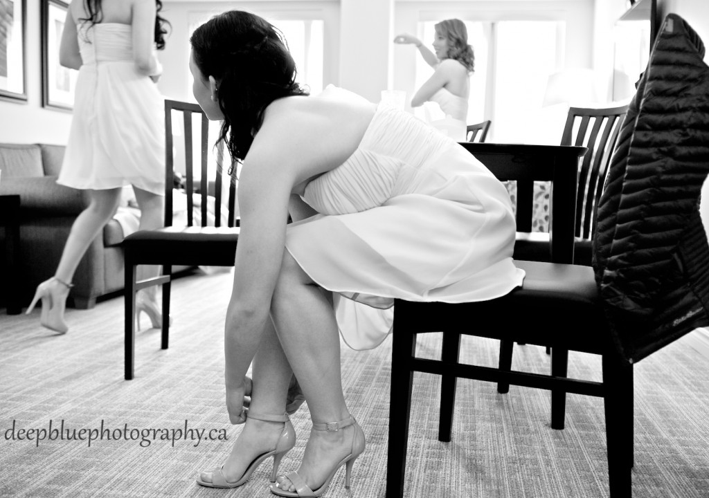 Photo of Bridesmaids Putting Shoes On
