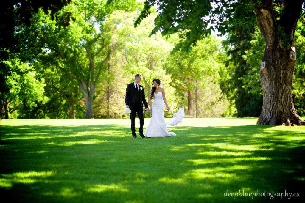 Outdoor summer wedding portrait of bride and groom at Legislature grounds