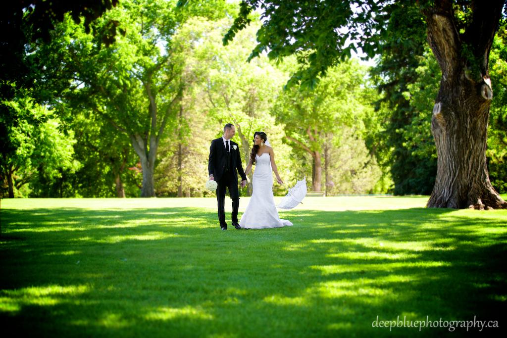 Outdoor summer wedding portrait of bride and groom at Legislature grounds