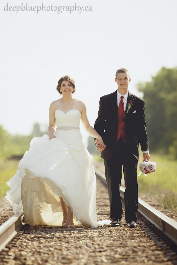 Alannah and Roland walk down train tracks