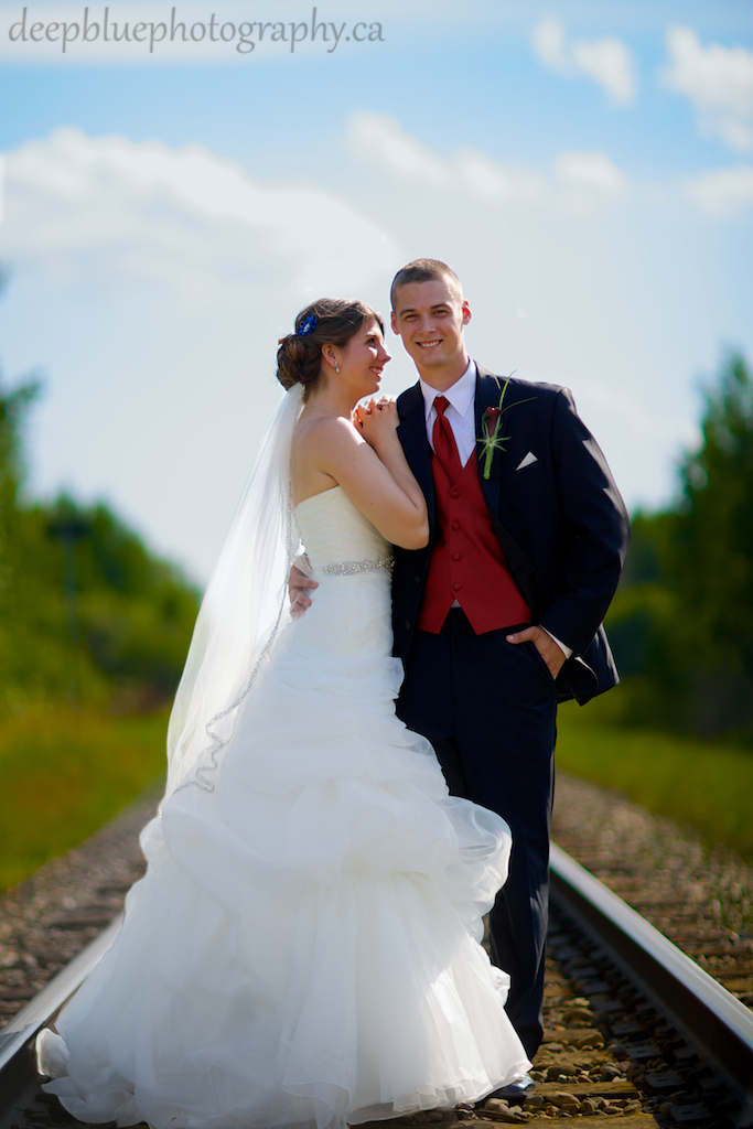 Romantic wedding portrait on train tracks