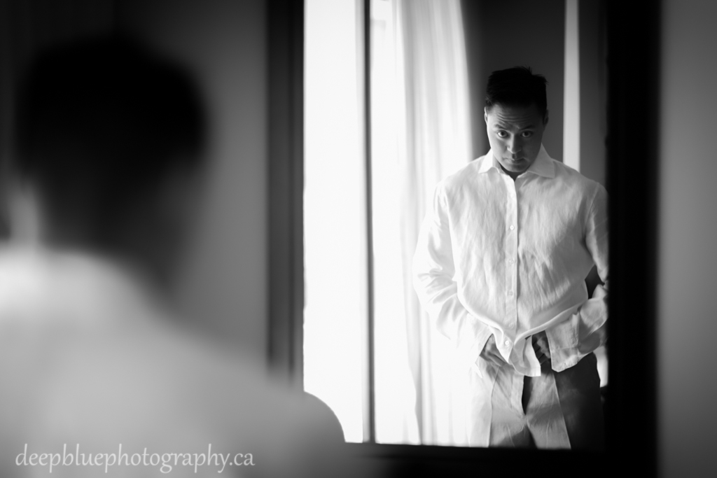 Photo of Chris getting dressed. mexico destination wedding photographers