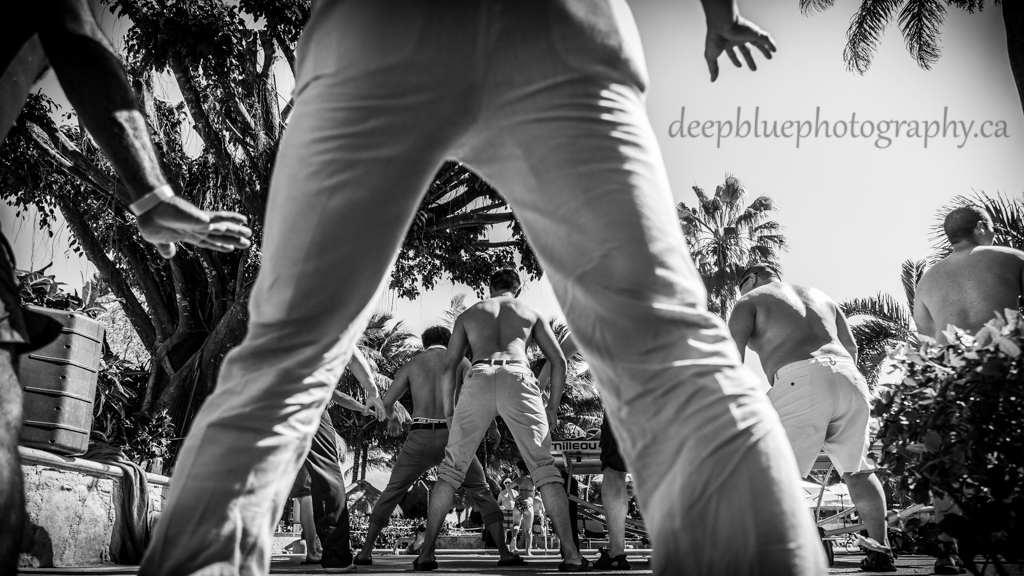 Photo of groom dancing By Mexico Destination Wedding Photographers Deep Blue Photography