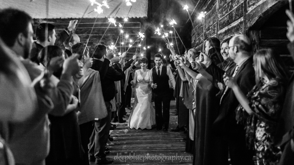 Outdoor winter wedding sparkler group photo