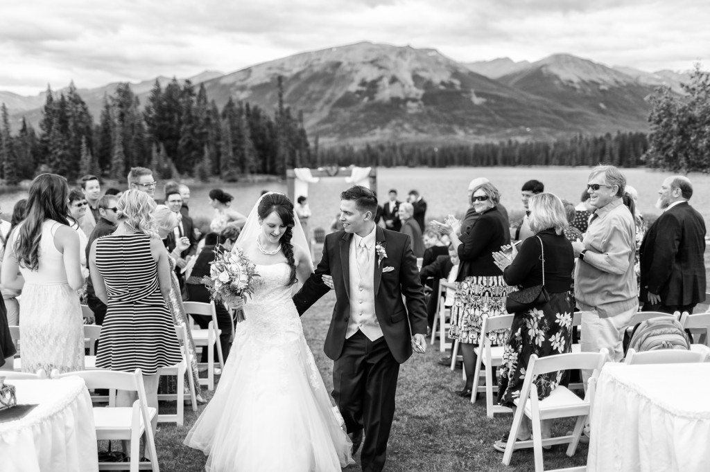 Photo of Bride and Groom Leaving Ceremony - Jasper Wedding Photographers