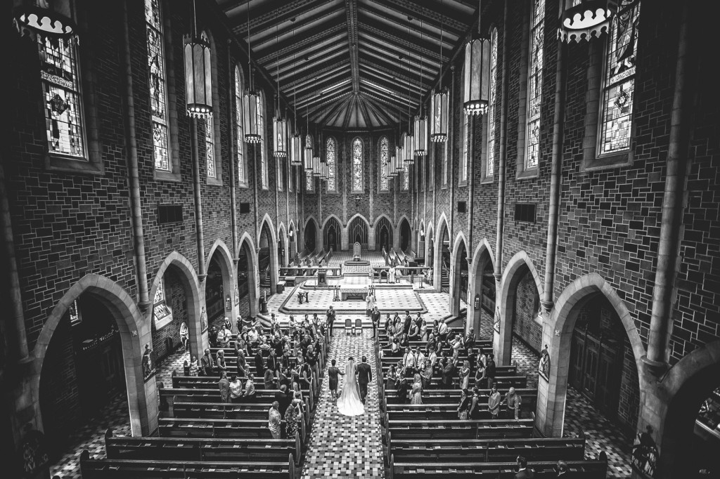 Bride walking down the aisle at St Joseph Basilica Wedding Edmonton Alberta