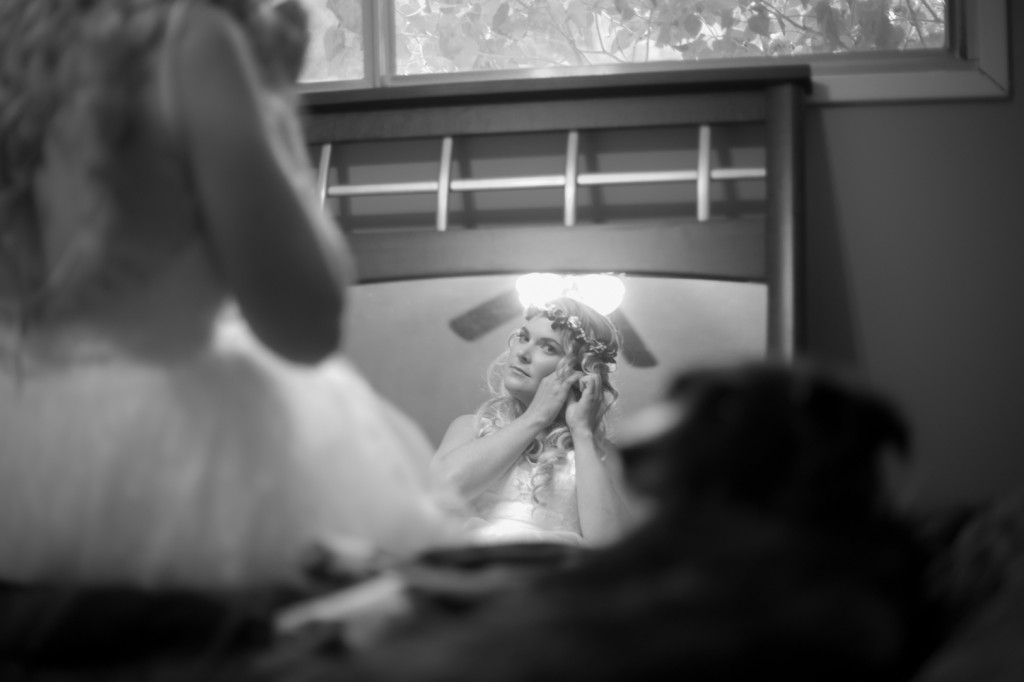 Photo of Bride Putting on Earrings