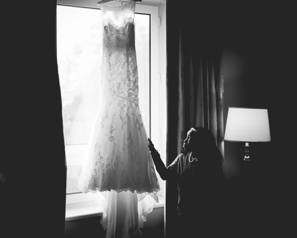 Photo of Flower Girl Looking at Wedding dress