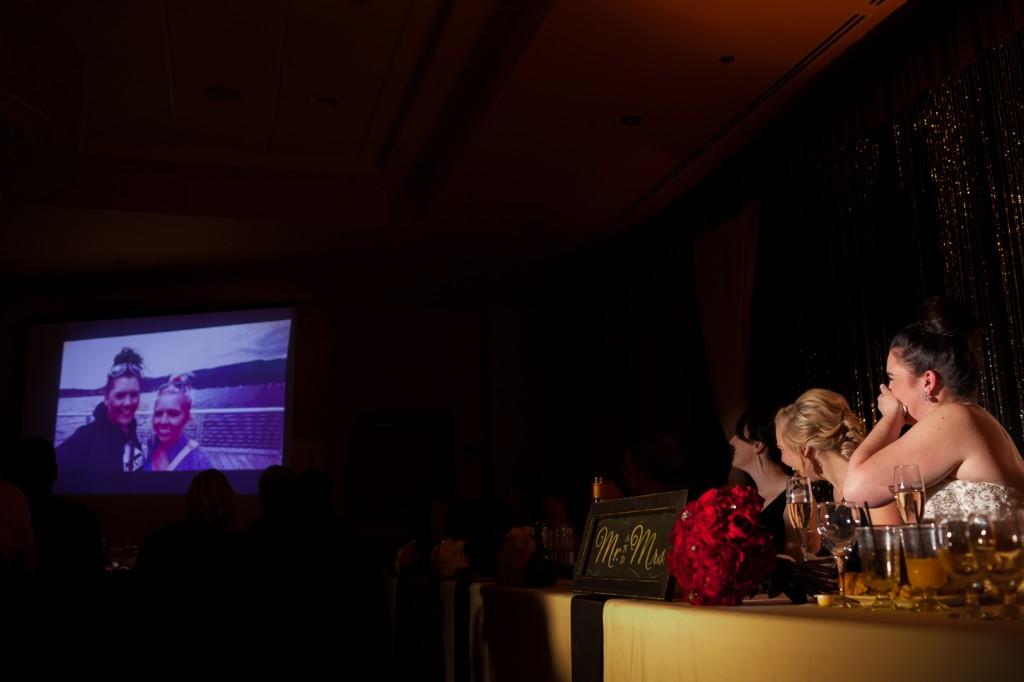 Photo of Bride and Groom Watching Slideshow