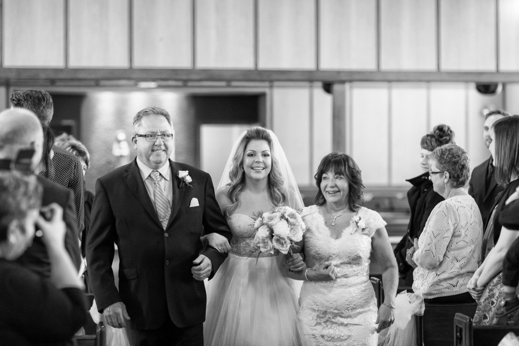 Photo of Bride Walking with Parents