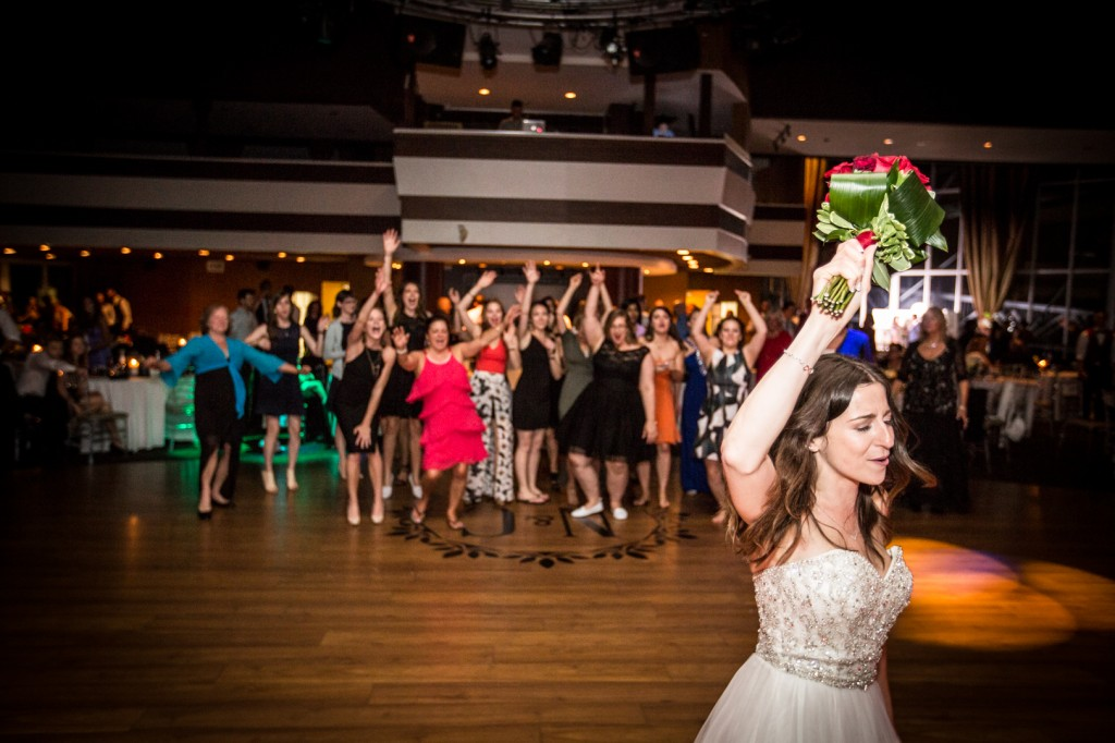 Bride Throwing Red Rose Bouquet