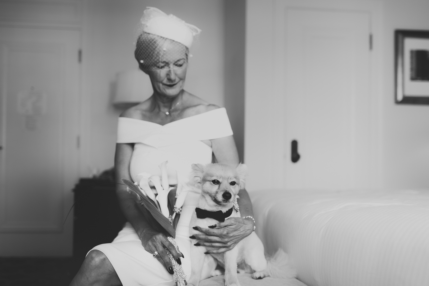 Photo of Bride and her Dog - Fairmont Hotel MacDonald Wedding.