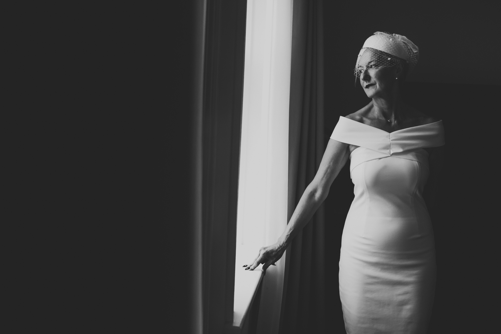 Bride posing by window - Fairmont Hotel MacDonald Wedding.