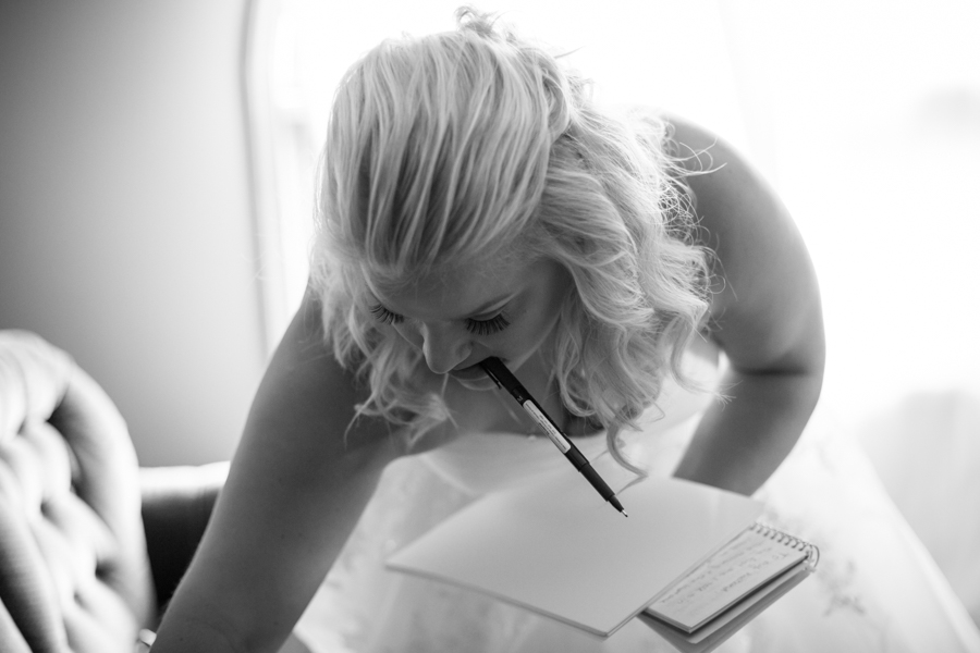 Bride writing vows.