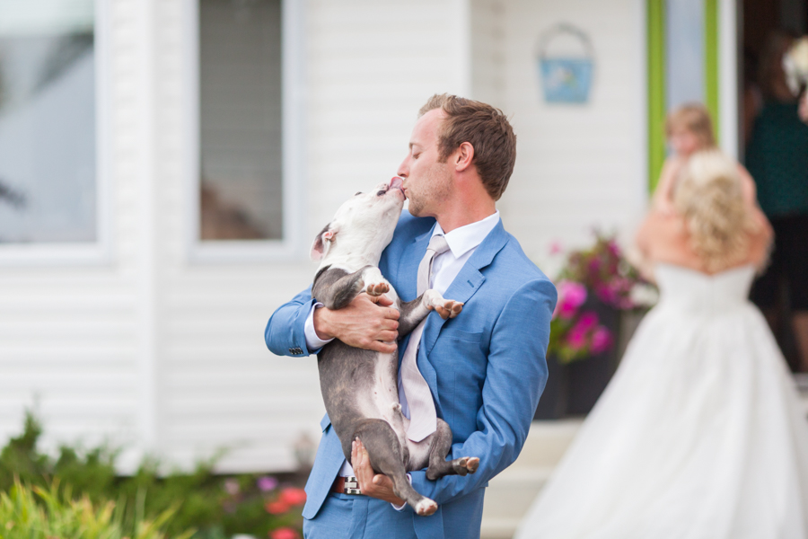 Groom with dog.