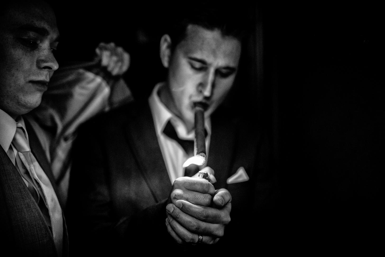 Photo of Groom Smoking Cigar