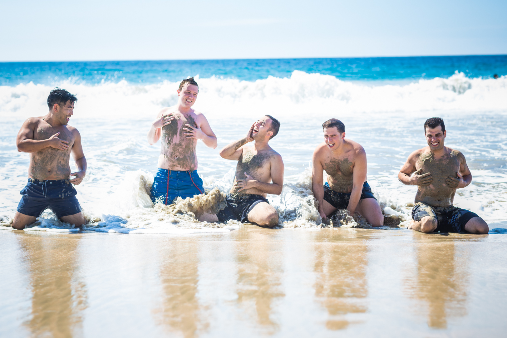 Groomsmen in the sand at Sunscape Dorado Pacifico Ixtapa destination wedding