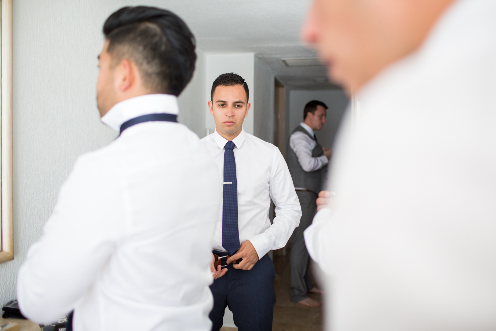 groom getting ready at his Sunscape Dorado Pacifico Ixtapa destination wedding