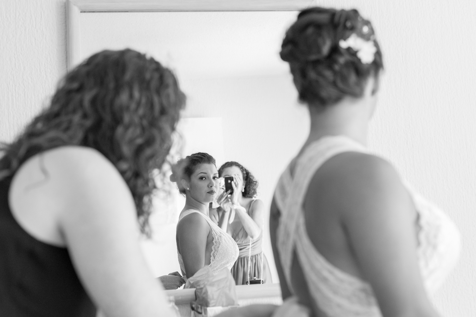 Bride putting on dress picture