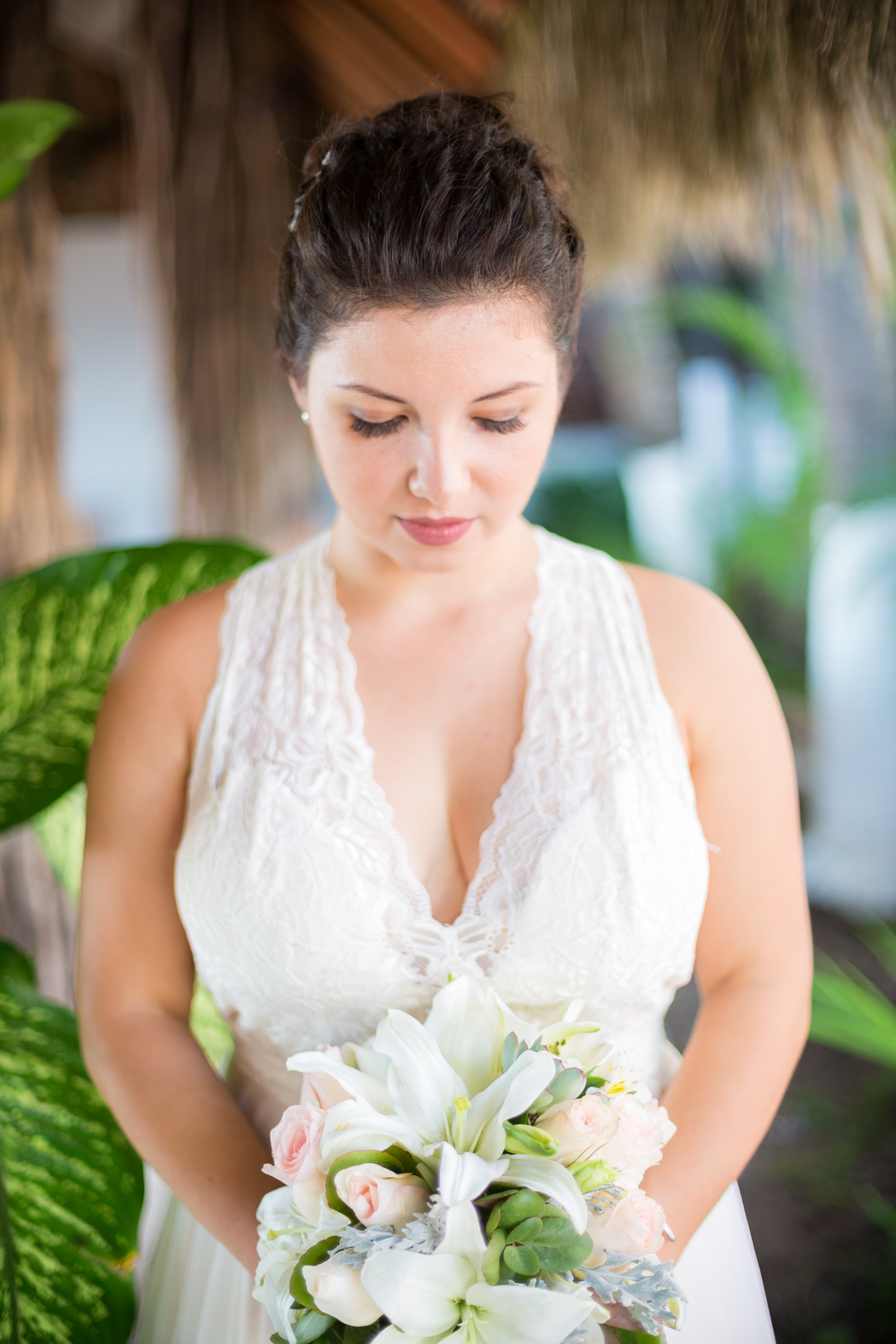 Bride with flowers at Sunscape Dorado Pacifico Ixtapa destination wedding