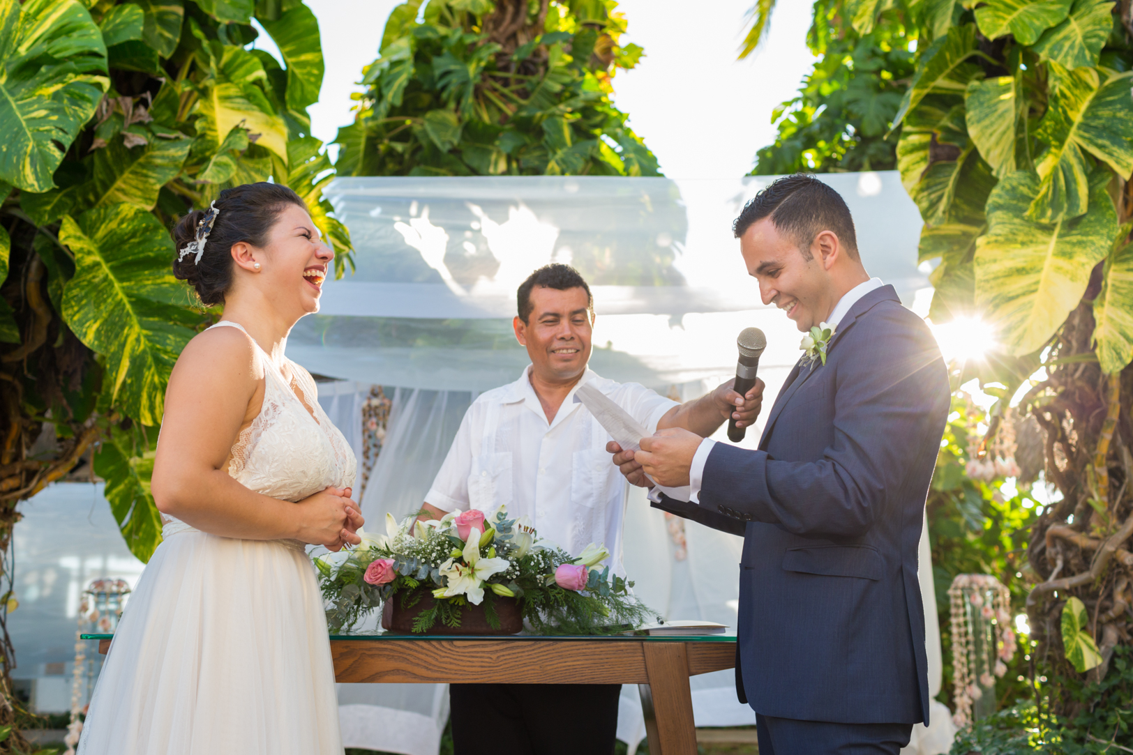 Reading vows to each other at Sunscape Dorado Pacifico Ixtapa destination wedding