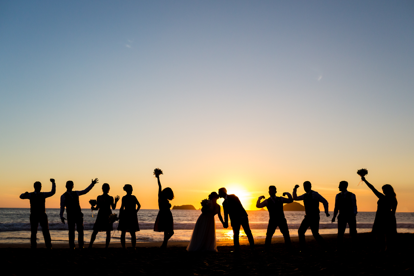 Creative bridal party picture at Sunscape Dorado Pacifico Ixtapa destination wedding at sunset