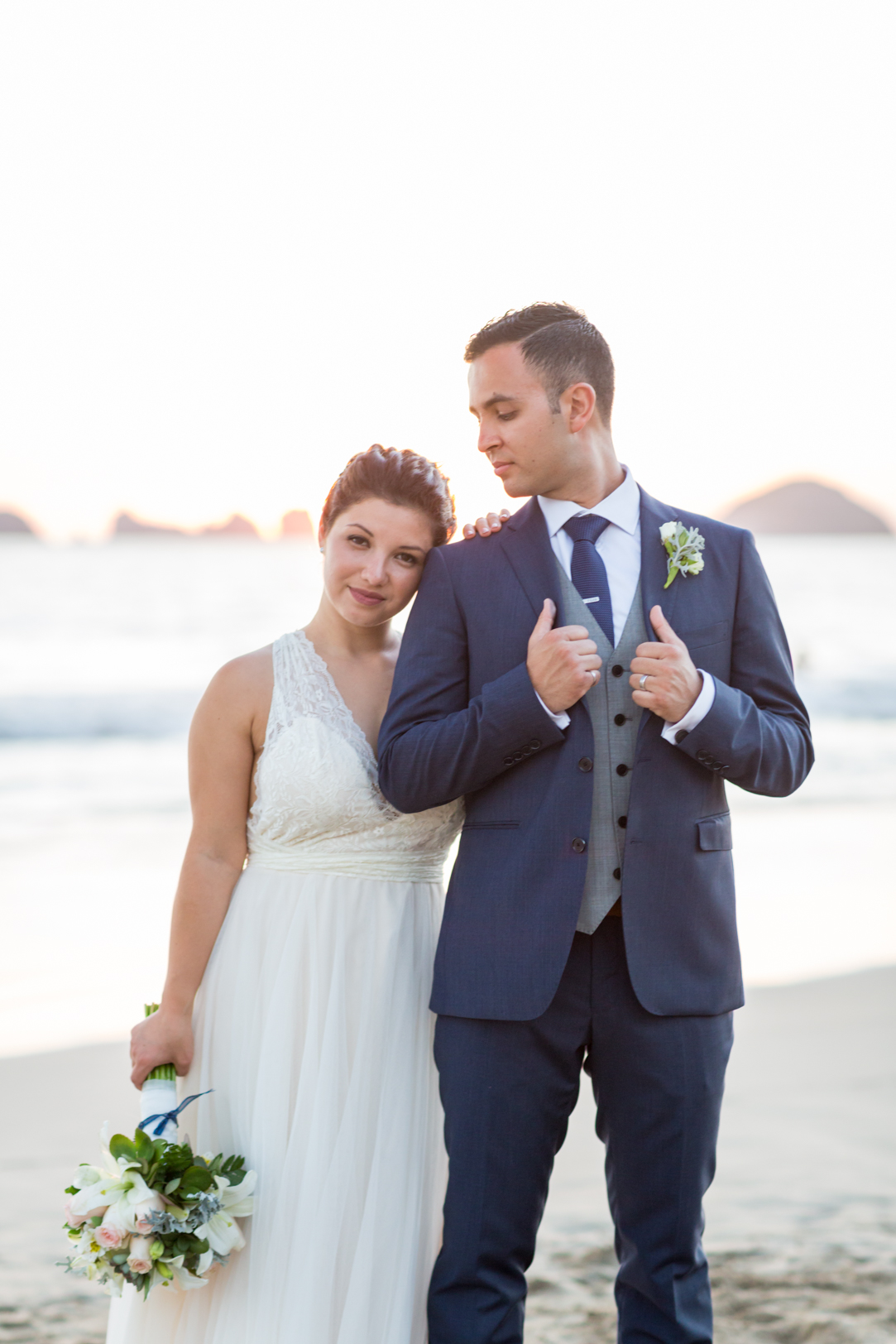 Bride and groom portrait on the beach at their Sunscape Dorado Pacifico Ixtapa destination wedding